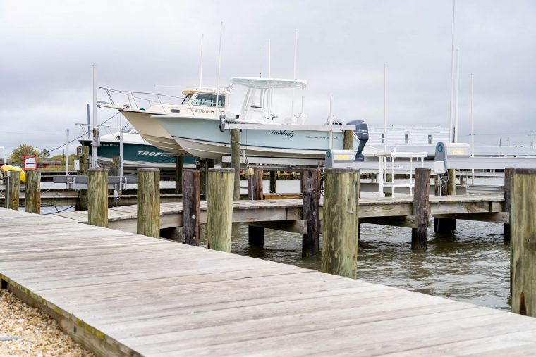 A photo of boats on a slip, Somers Cove, Crisfield Maryland
