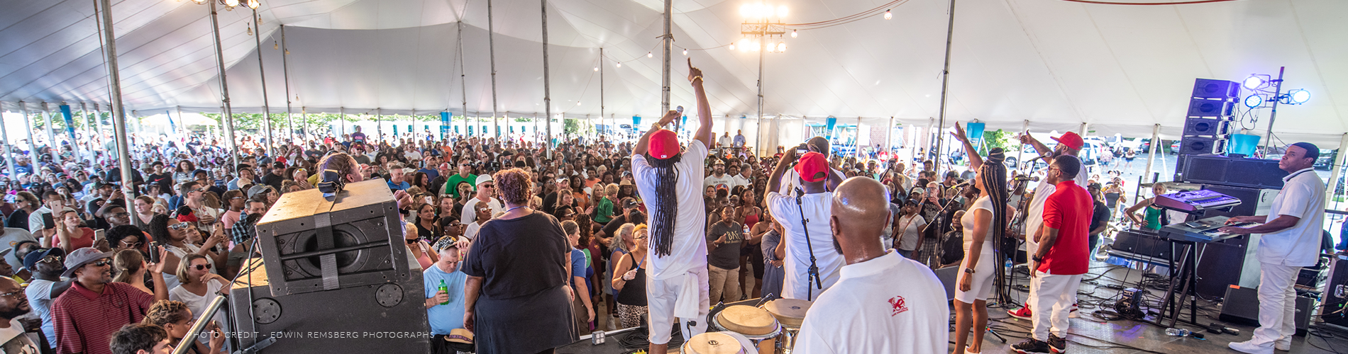 A photo of a band in front of a crowd at the National Folk Festival